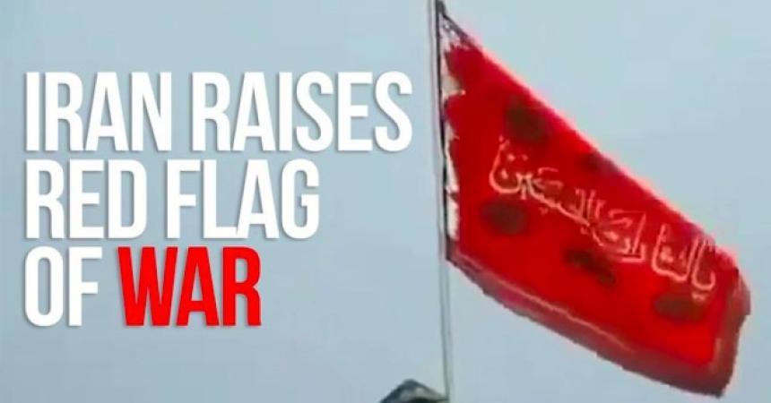 Irans röda flagga varnar för krig.