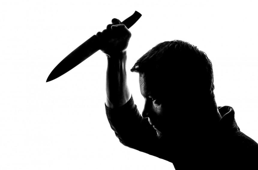 Man with knife.