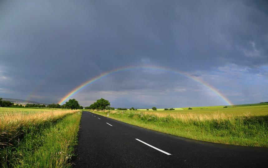 Rainbow over a road.